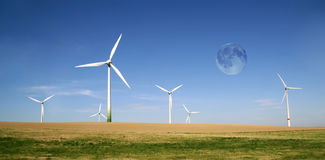 Wind turbines farm with full moon stock photo