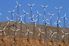 Wind-turbines farm generating clean power energy Royalty Free Stock Photos