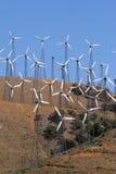 Wind-turbines farm generating clean power energy Stock Image