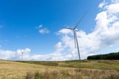 Wind turbines on a farm Stock Photo