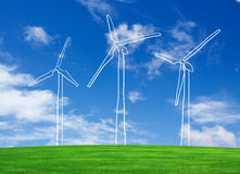 Wind turbines farm on green field Stock Photo