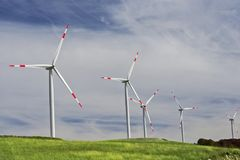 Wind turbines at a wind farm on a hill. Creating renewable energy in Montenegro stock images