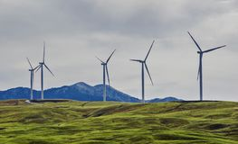 Wind turbines at a wind farm on a hill. Creating renewable energy in Montenegro royalty free stock photo