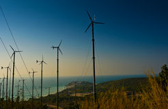 Wind turbines farm on the island Stock Images