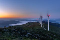 Wind turbines farm, Oiz mountain, Basque Country, Spain. Wind turbines farm at dawn, Oiz mountain, Basque Country in Spain royalty free stock image