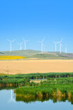 Wind turbines farm on a rural background Stock Photo
