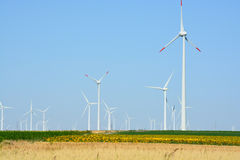 Wind turbines farm on a rural background Stock Image