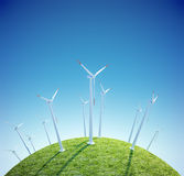 Wind turbines farm on a small green planet Royalty Free Stock Photos