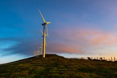 Wind turbines farm at sunrise, Oiz mountain, Basque Country, Spain. Wind turbines farm at sunrise, Oiz mountain, Basque Country in Spain stock photography