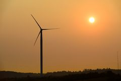 Wind turbines farm at sunset in Dobrogea Royalty Free Stock Image