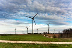 Wind turbines farm on sunset in spring Royalty Free Stock Images