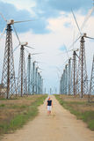 Wind turbines farm and walking person Stock Images