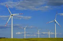 Wind turbines farm. Windmill Stock Image