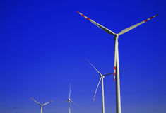 Wind turbines farm. Windmill Stock Photo