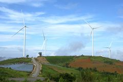 Wind turbines farmland for generating electricity in Southeast Asia. Stock Image