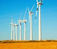 Wind Turbines at farmland Stock Images