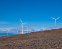 Wind turbines with fast moving blades Royalty Free Stock Image