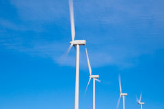 Wind turbines with fast moving blades Royalty Free Stock Photos