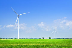 Wind turbines in field Royalty Free Stock Photos