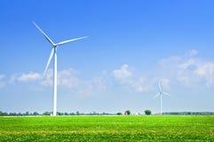 Wind turbines in field. Green alternative clean power wind turbines in field Royalty Free Stock Photos