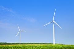 Wind turbines in field. Green alternative clean power wind turbines in field Stock Images