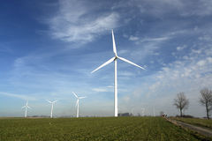 Wind turbines in a field. Royalty Free Stock Image