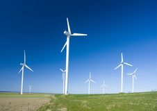 Wind turbines in a field. Royalty Free Stock Images