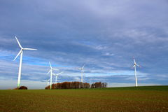 Wind turbines on a field Royalty Free Stock Image