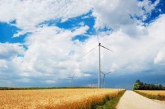 Wind turbines in a field Royalty Free Stock Photography