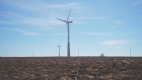 Eco-energy concept. Wind turbines in the field. Eco-energy concept stock video footage