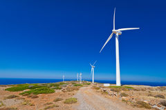 Wind turbines field over blue sky. On Crete, Greece Royalty Free Stock Photos