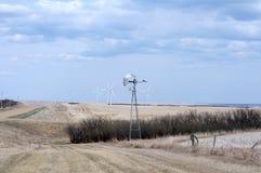 Wind turbines in field in Alberta Royalty Free Stock Photos