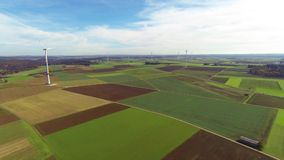 Wind turbines and fields stock video