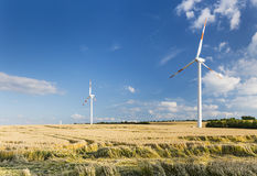 Wind Turbines And Fields Stock Image