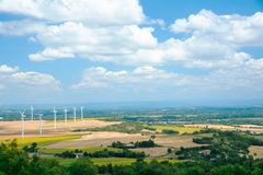 Wind turbines in France. Fields with windmills. Field in bloom. Renewable energy. Protect the environment stock images