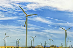 Wind turbines in front of blue sky Stock Image