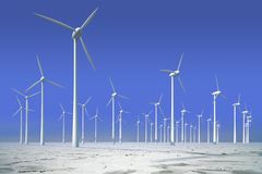 Wind turbines in frozen water Stock Photography