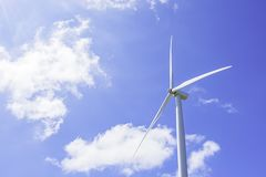 Wind turbines generate electricity and the bright blue sky at Khao Kho of phetchabun in Thailand.  royalty free stock image