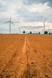 Wind turbines generate electricity at field all agriculture plantation Royalty Free Stock Photo