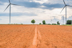Wind turbines generate electricity at field all agriculture plantation Royalty Free Stock Photos