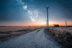 Wind turbines generates power while Night stock photography