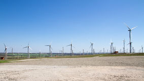 Wind turbines generating electicity. Alternative sources of green energy - wind turbins or wind farms stock images