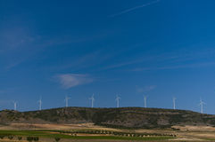 Wind Turbines Generating Electrical Power. Hill with Wind Turbines Farm. Wind Turbines Generating Electrical Power royalty free stock image