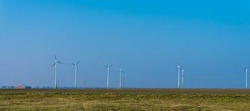Wind turbines generating electricity. alternative wind energy  blue sky .inn Stock Photography