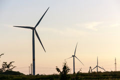 Wind turbines generating electricity on background of sky royalty free stock image