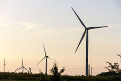 Wind turbines generating electricity on background of sky royalty free stock photo