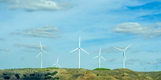 Wind turbines generating electricity on blue sky, alternative en. Ergy source, environment stock image