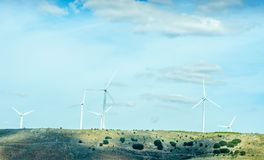 Wind turbines generating electricity on blue sky, alternative en. Ergy source, environment royalty free stock photos