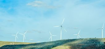 Wind turbines generating electricity on blue sky, alternative en. Ergy source, environment royalty free stock images