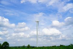 Wind turbines generating electricity on blue sky background .Eco power.  royalty free stock photos